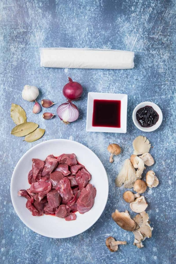 Ingredients to make game pie, raw venison, spices