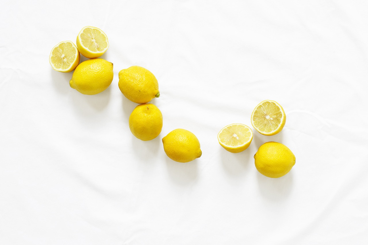 8 lemons on a counter