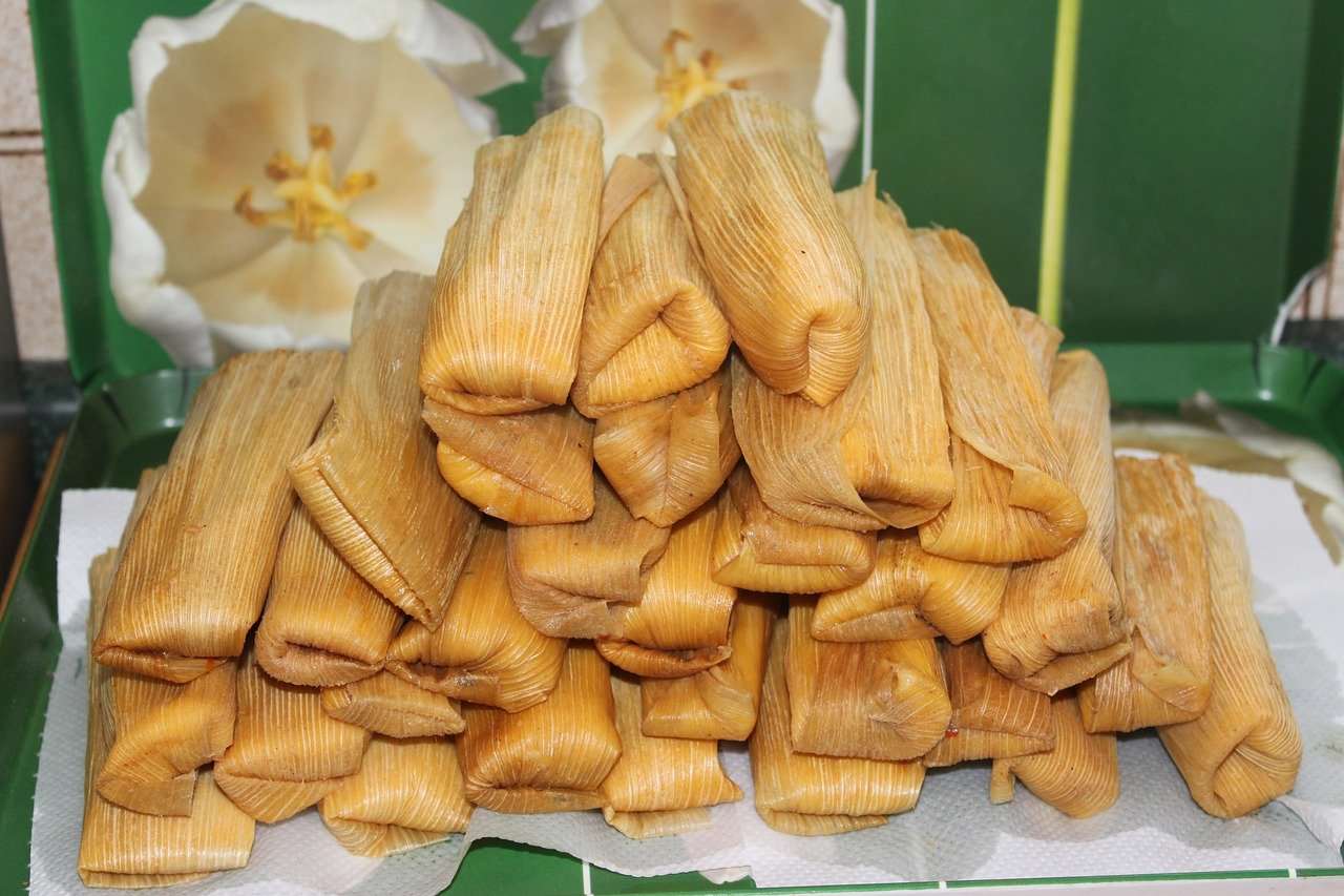 A pile of wrapped tamales
