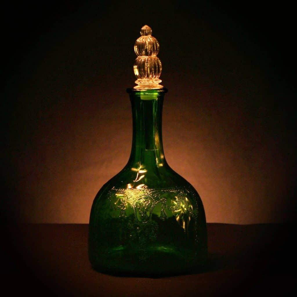 A green bottle of vinegar