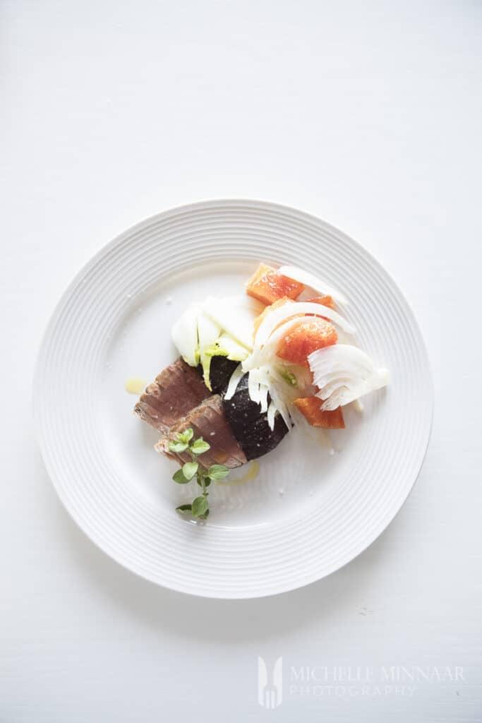 A plate of seared tuna salad