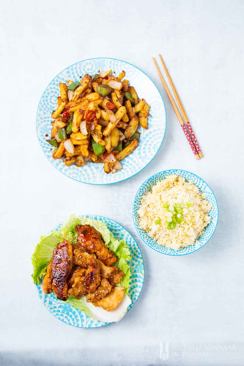 Three plates of food to make an asian meal