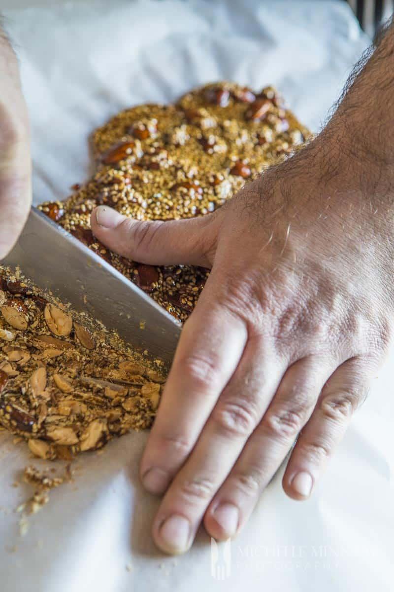 A mans hands chopping brittle