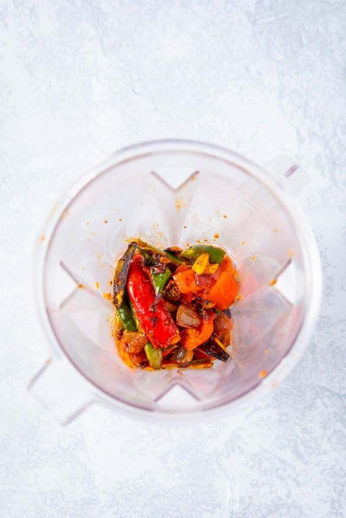 Cooked vegetables in a blender to make sambal oelek