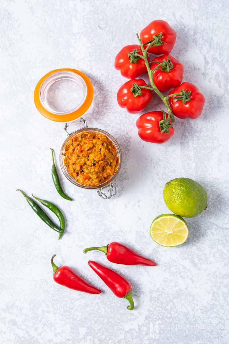 A jar of sambal oelek and peppers
