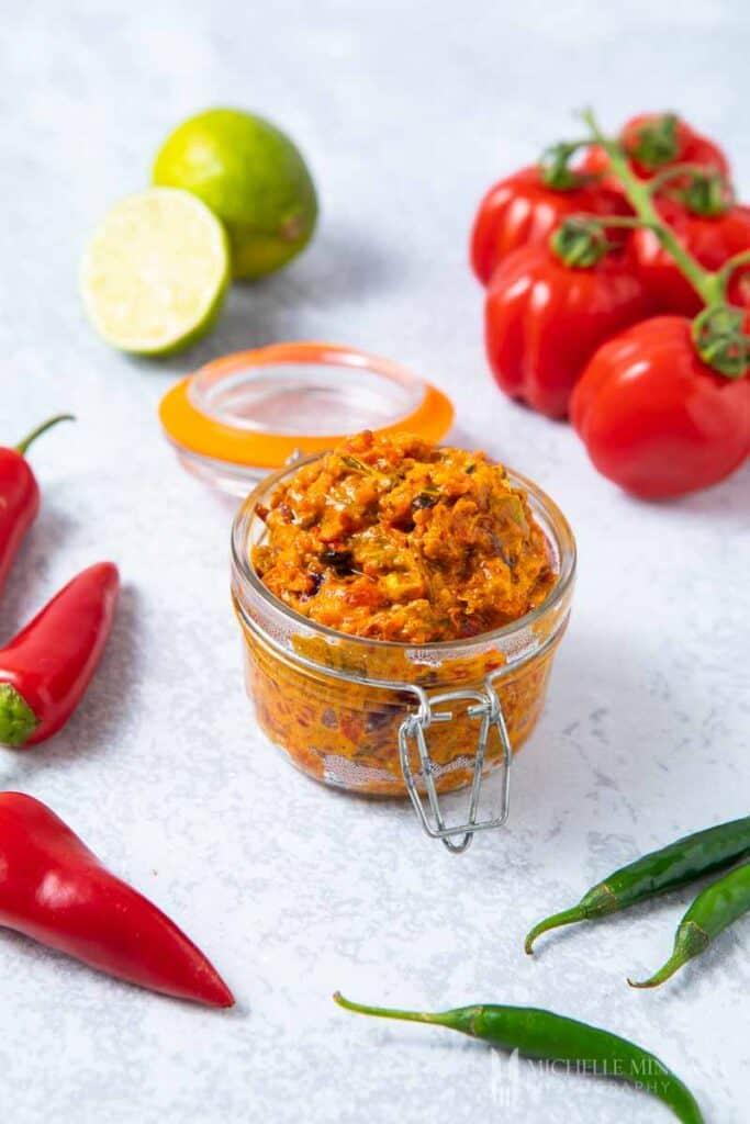 a clear jar of sambal oelek