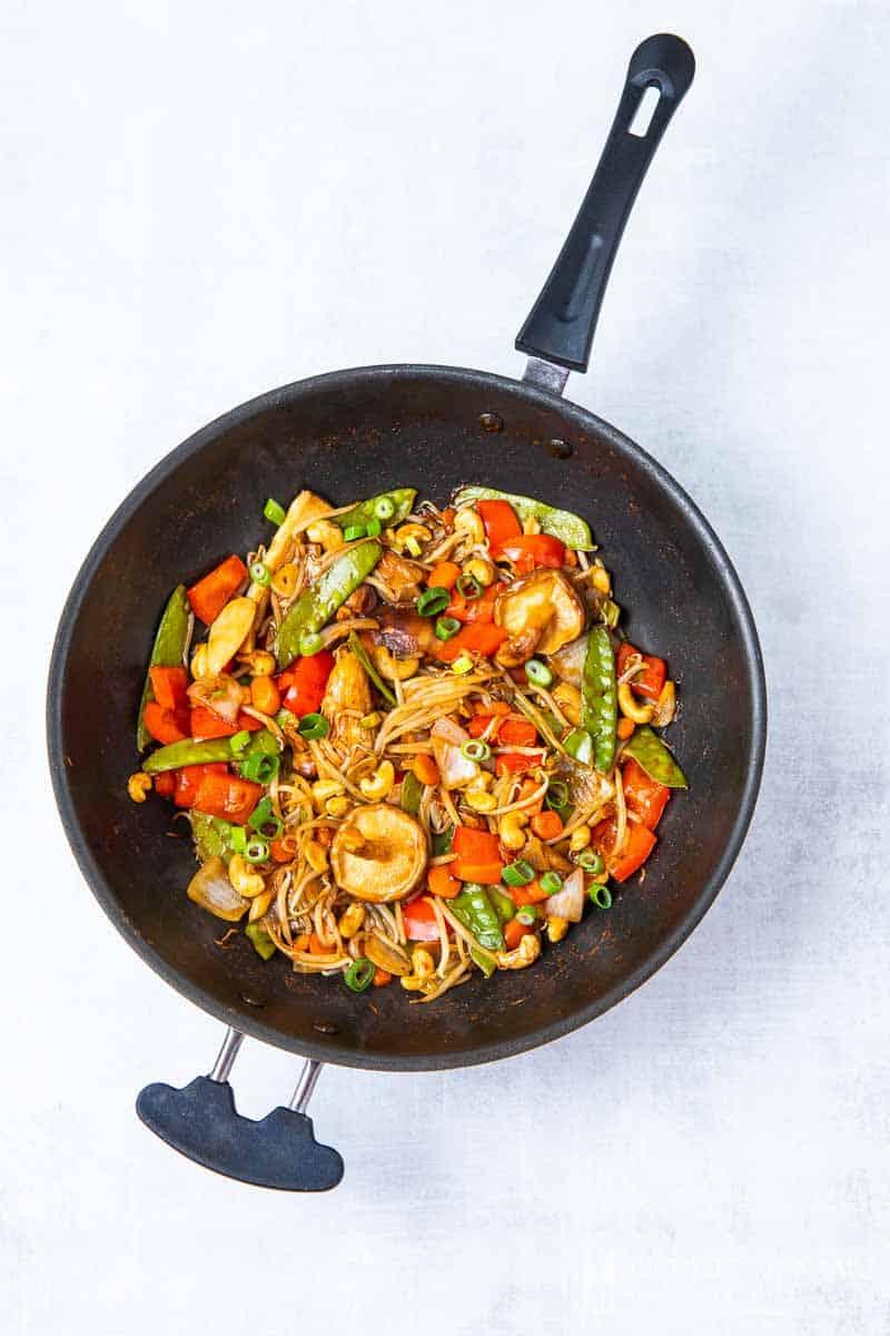 A saute pan full of chinese ingredients to make vegan chop suey