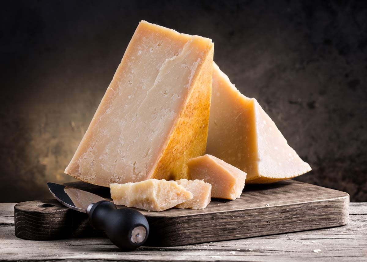 A large block of yellow parmesan cheese