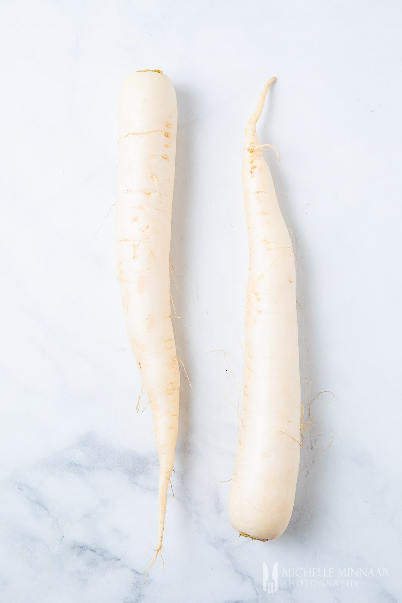 Two white daikon radishes