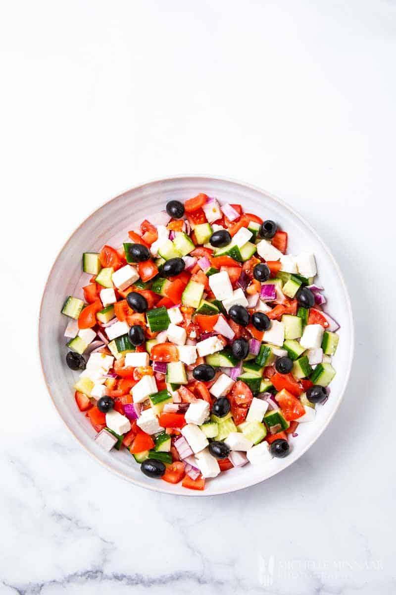 A bowl of Mediterranean salad