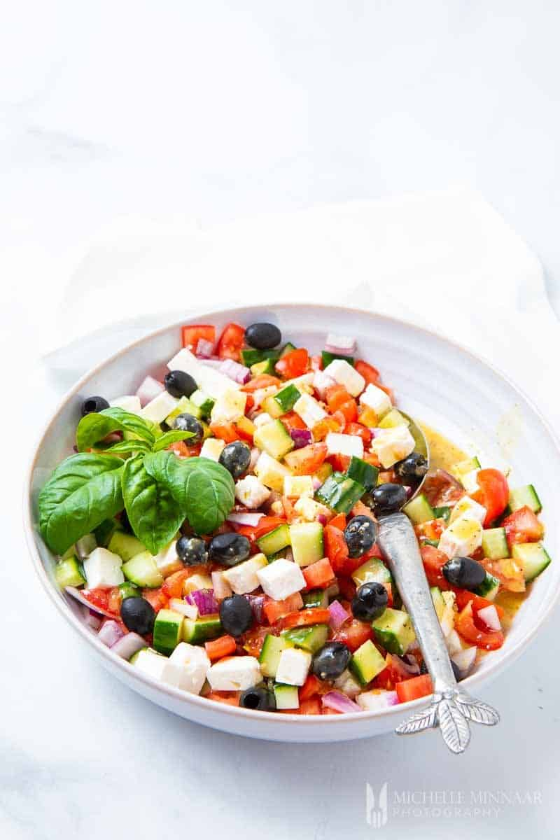 A large colorful bowl of Mediterranean salad
