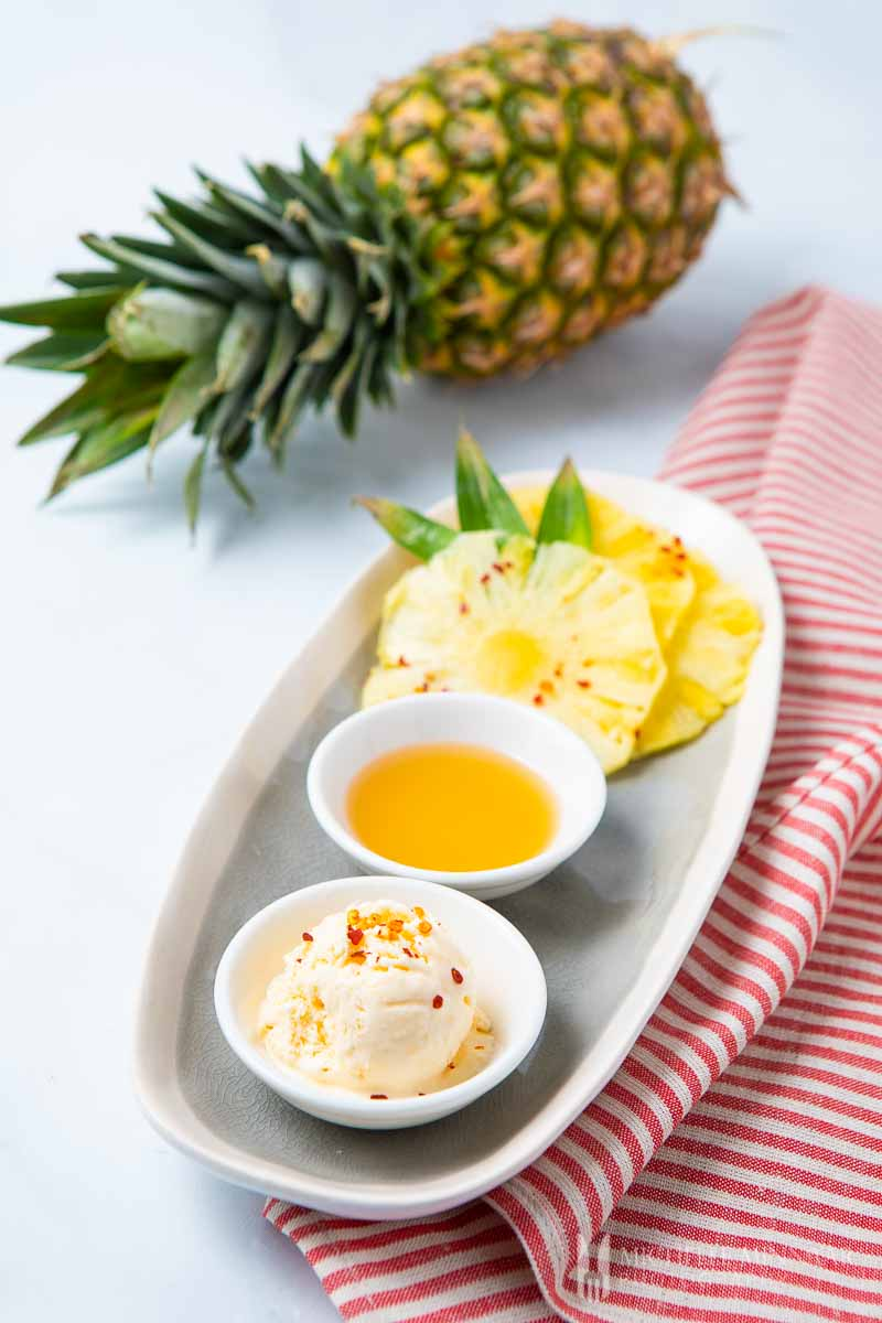 Scoop of pineapple ice cream and a whole pineapple