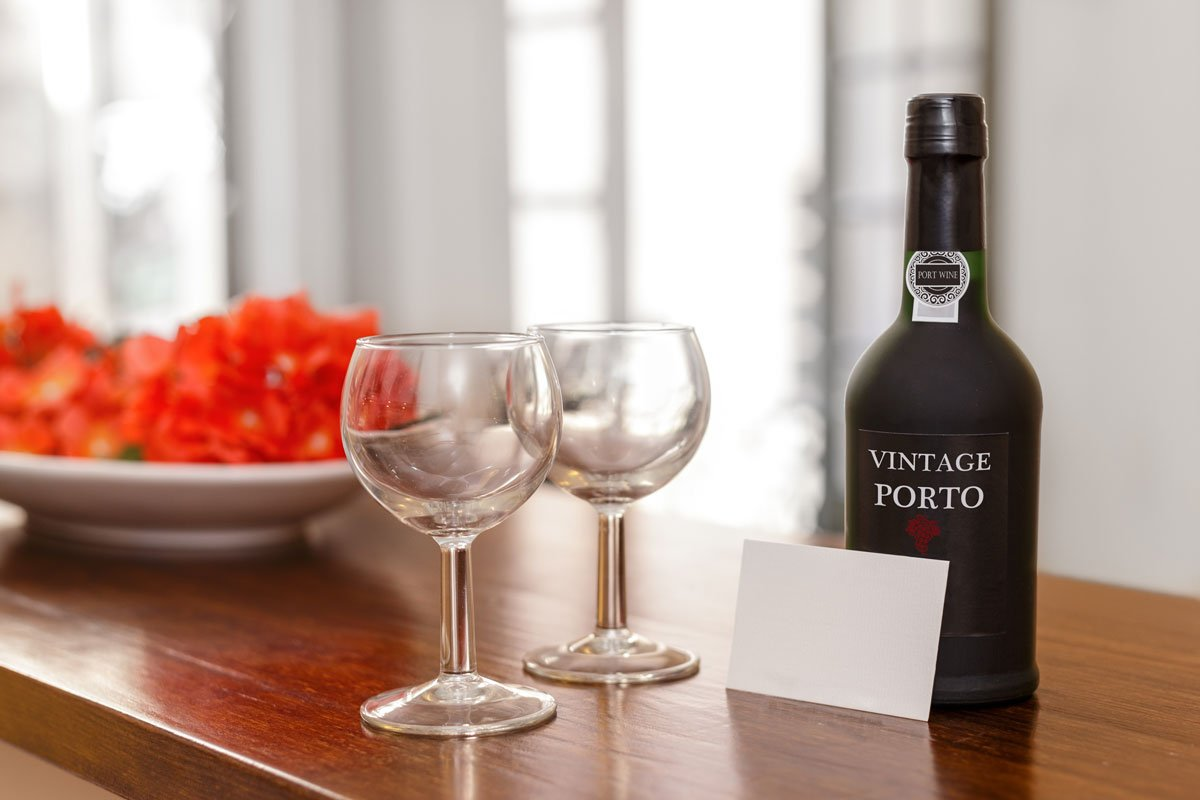 Two wine glasses and one bottle of port wine to be used as a madeira wine substitute