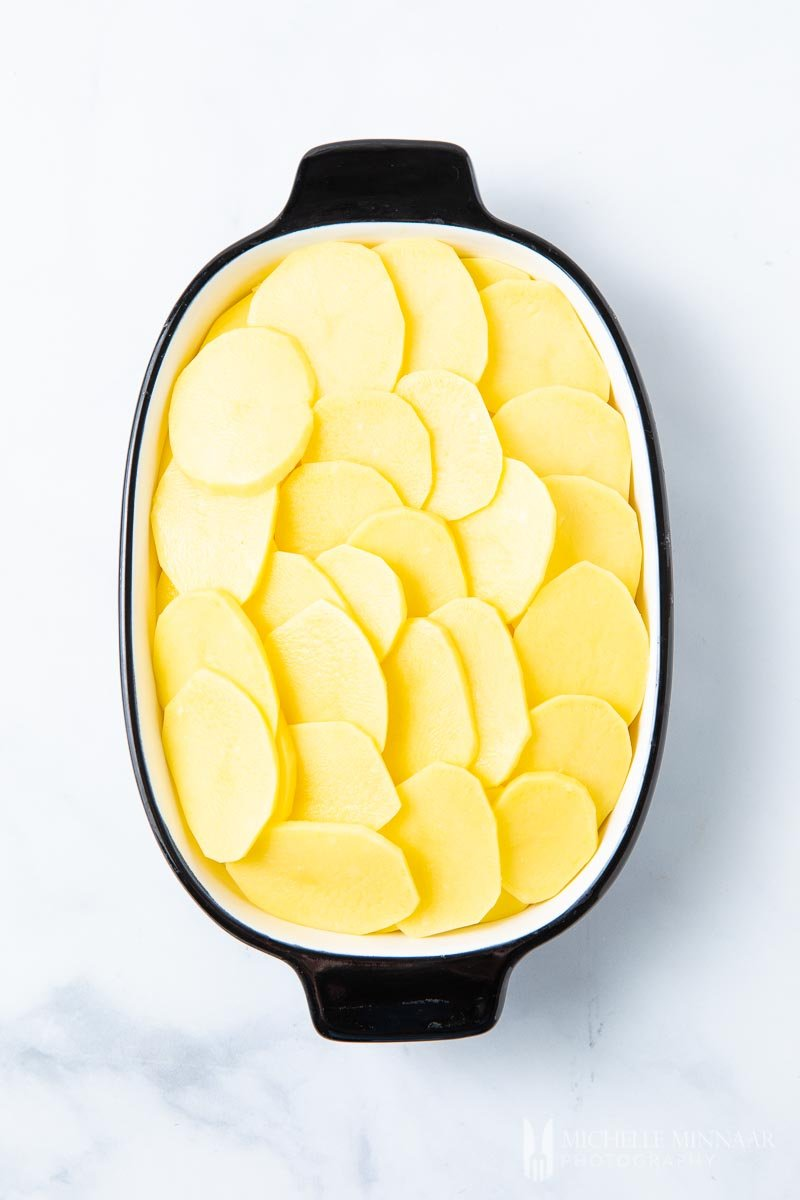 A casserole dish of sliced potatoes