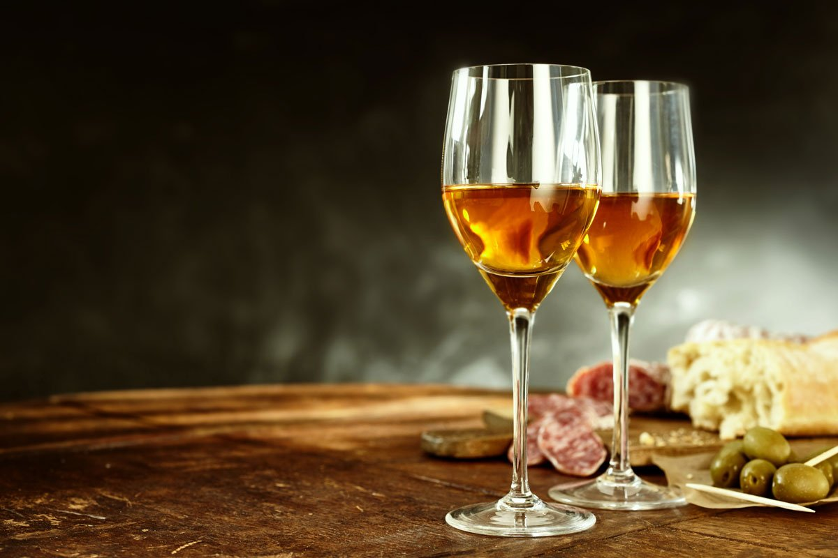 Two glasses of light brown sherry wine