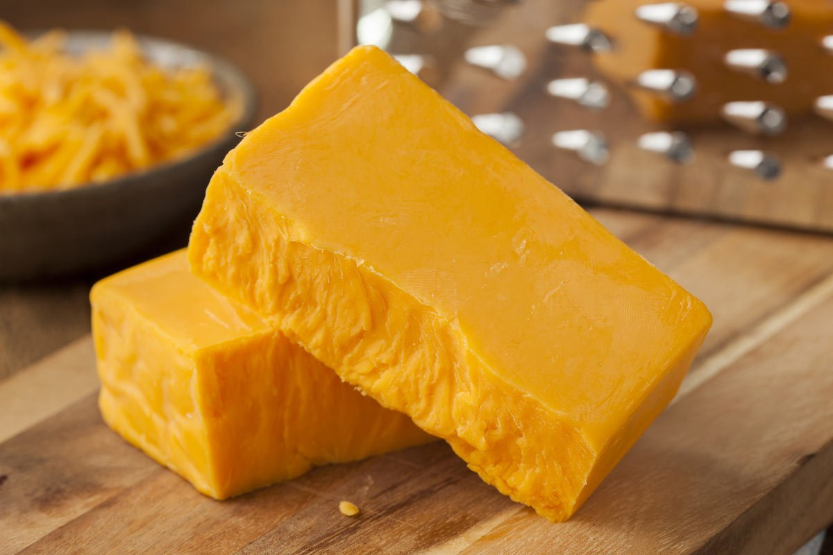 A large yellow cheddar cheese block
