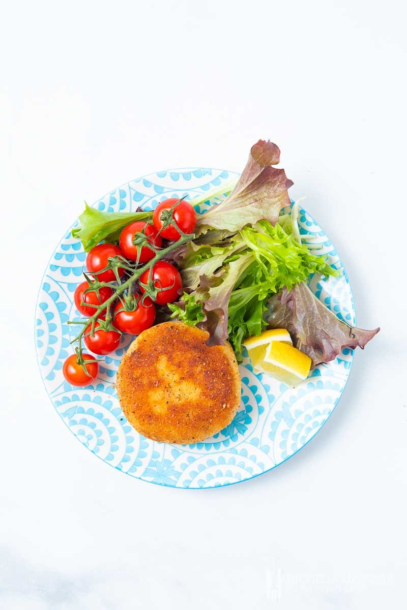 An aerial view of a salmon fish cake and salad