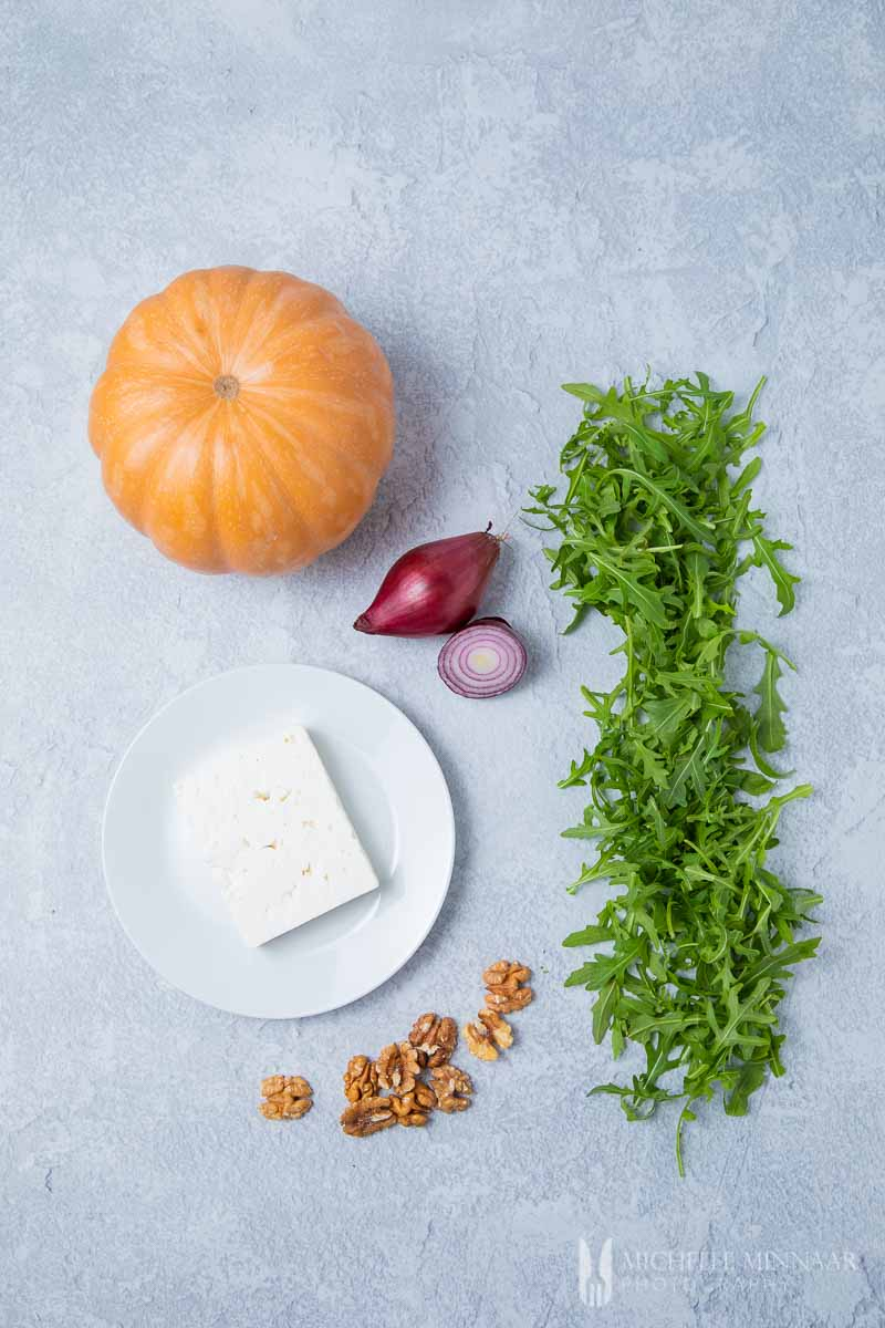 Ingredients to make a pumpkin and feta salad