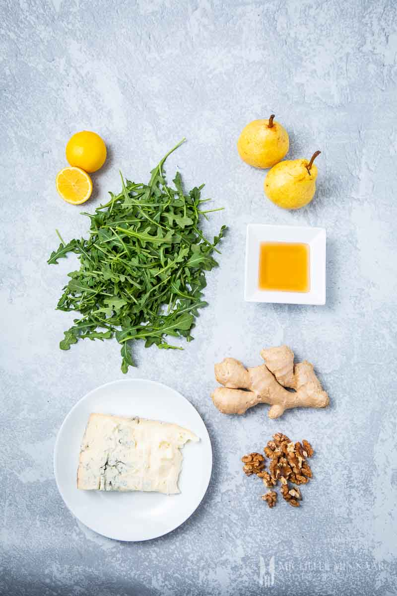 Ingredients to make pear and rocket salad