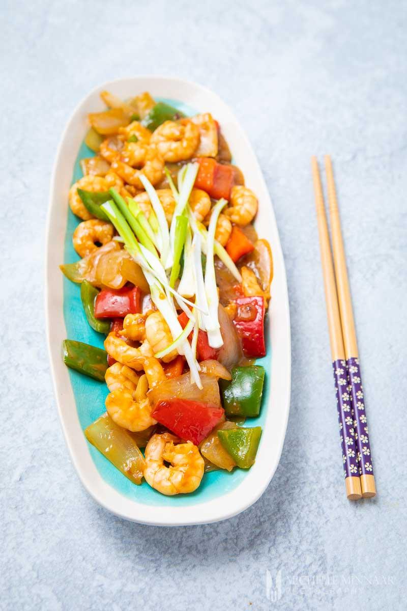 A long plate of shrimp in oyster sauce