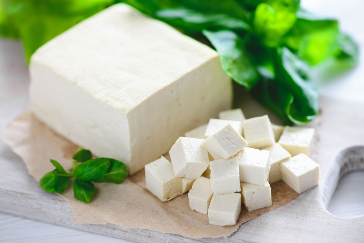 A white block of firm tofu