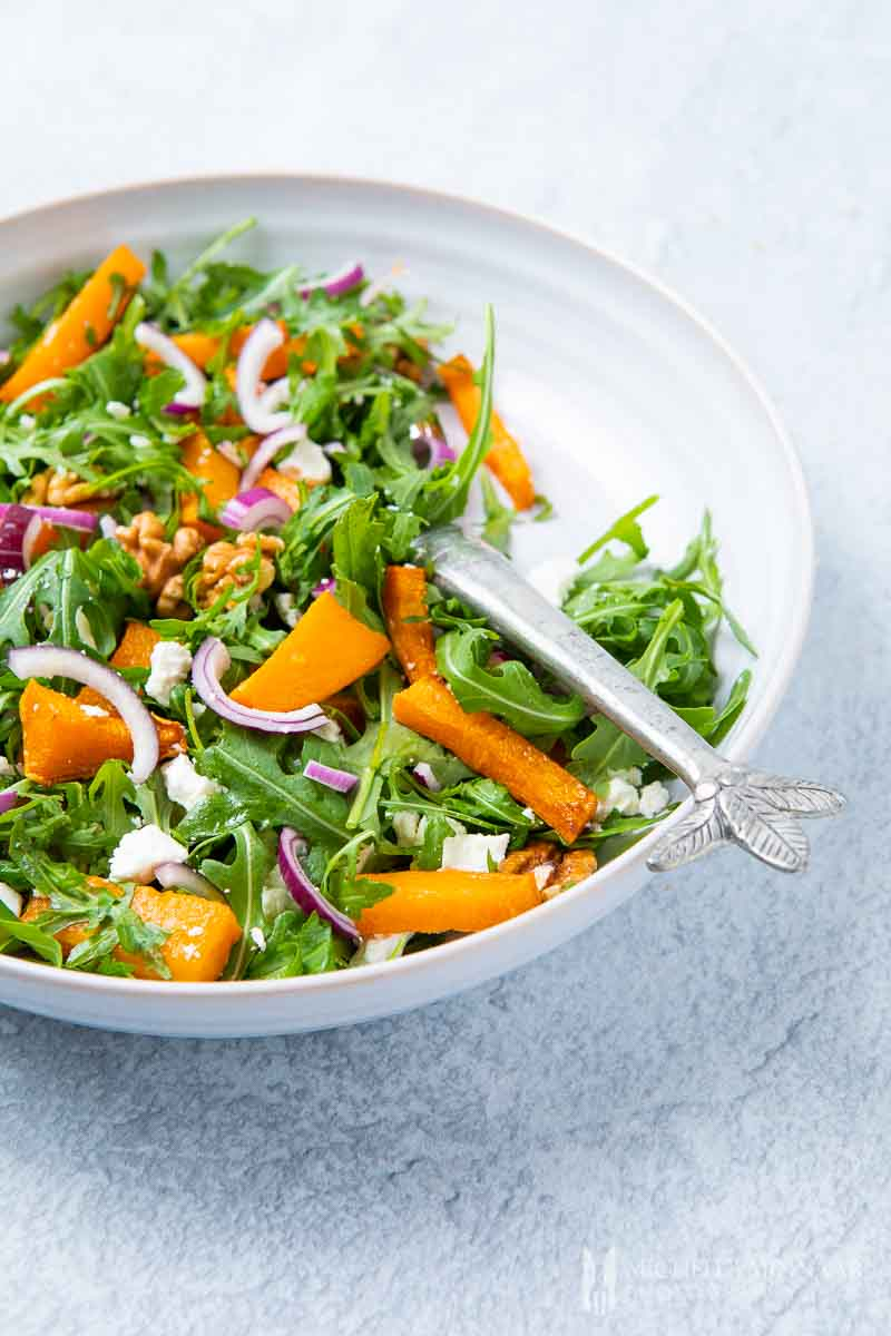 A large bowl of pumpkin and feta salad