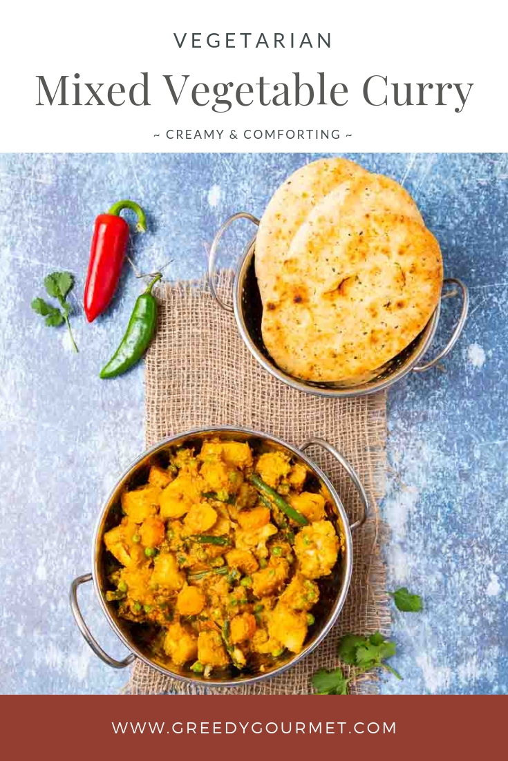 Bowl of mixed vegetable curry and naan bread