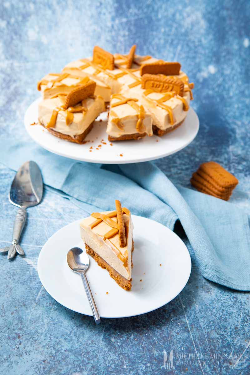 A slice of biscoff cheesecake and a full pie
