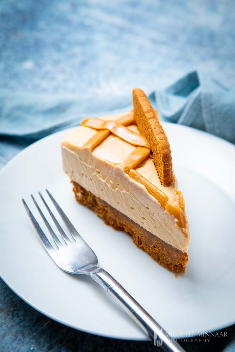 A slice of biscoff cheesecake