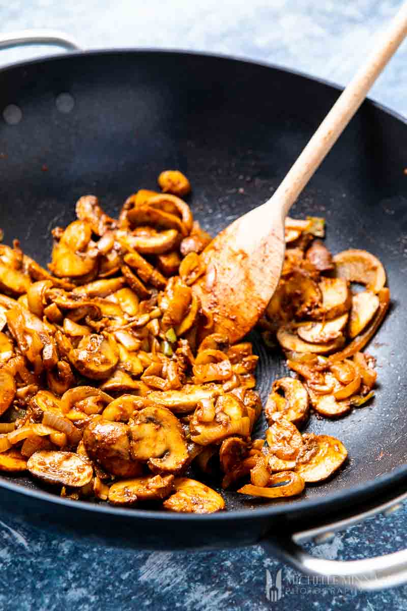 Mushrooms being sauteed in pan