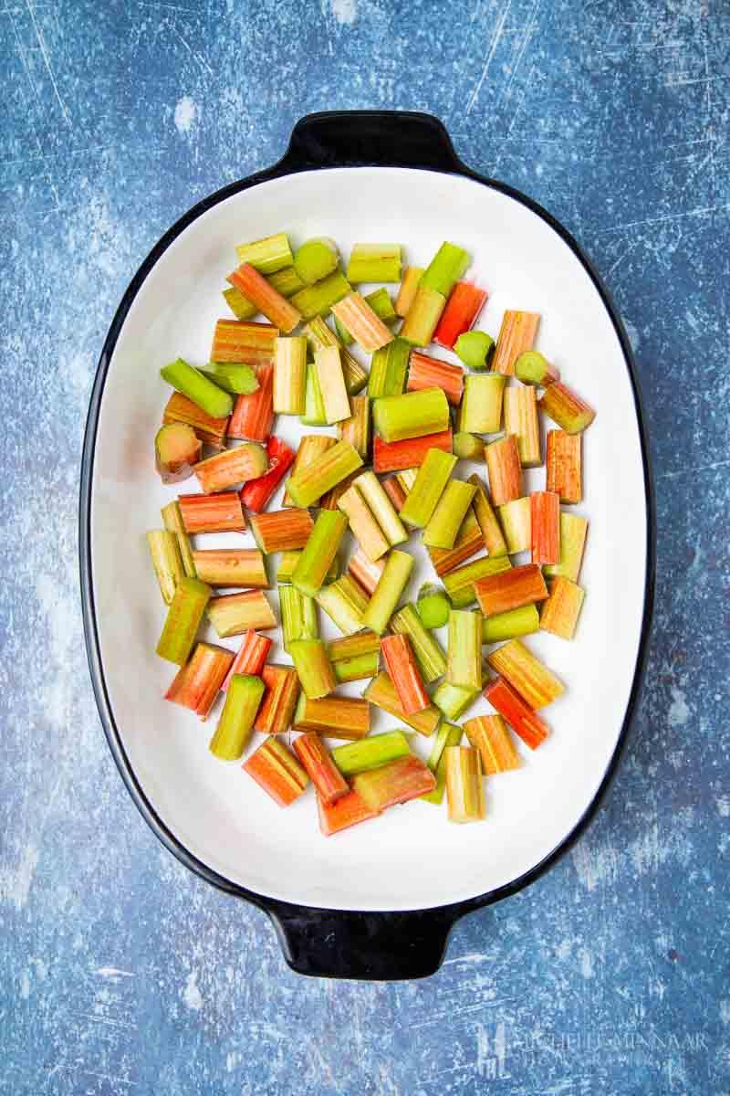 Cut up rhubarb in a casserole dish