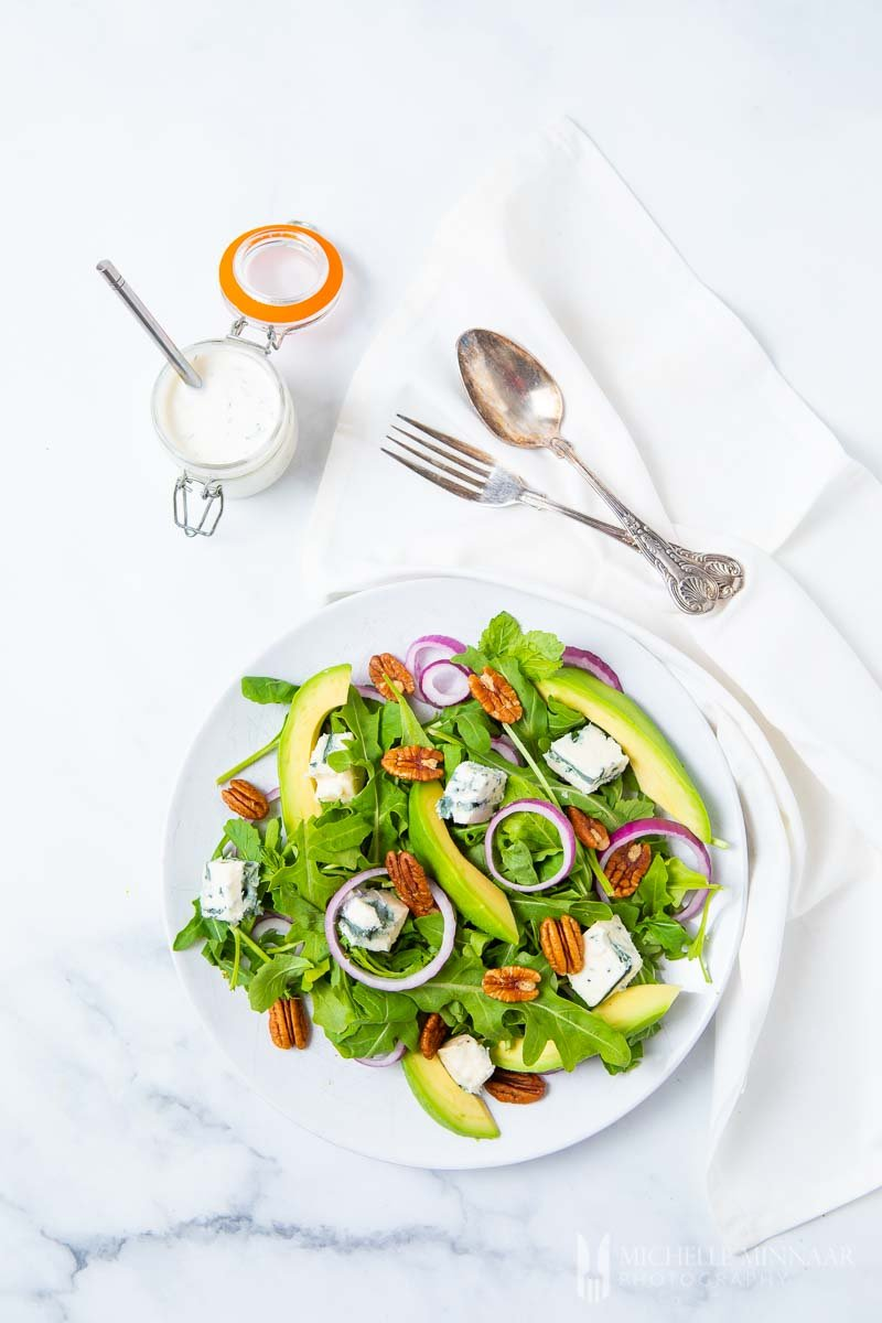 A fresh green rocket salad with avocado slices