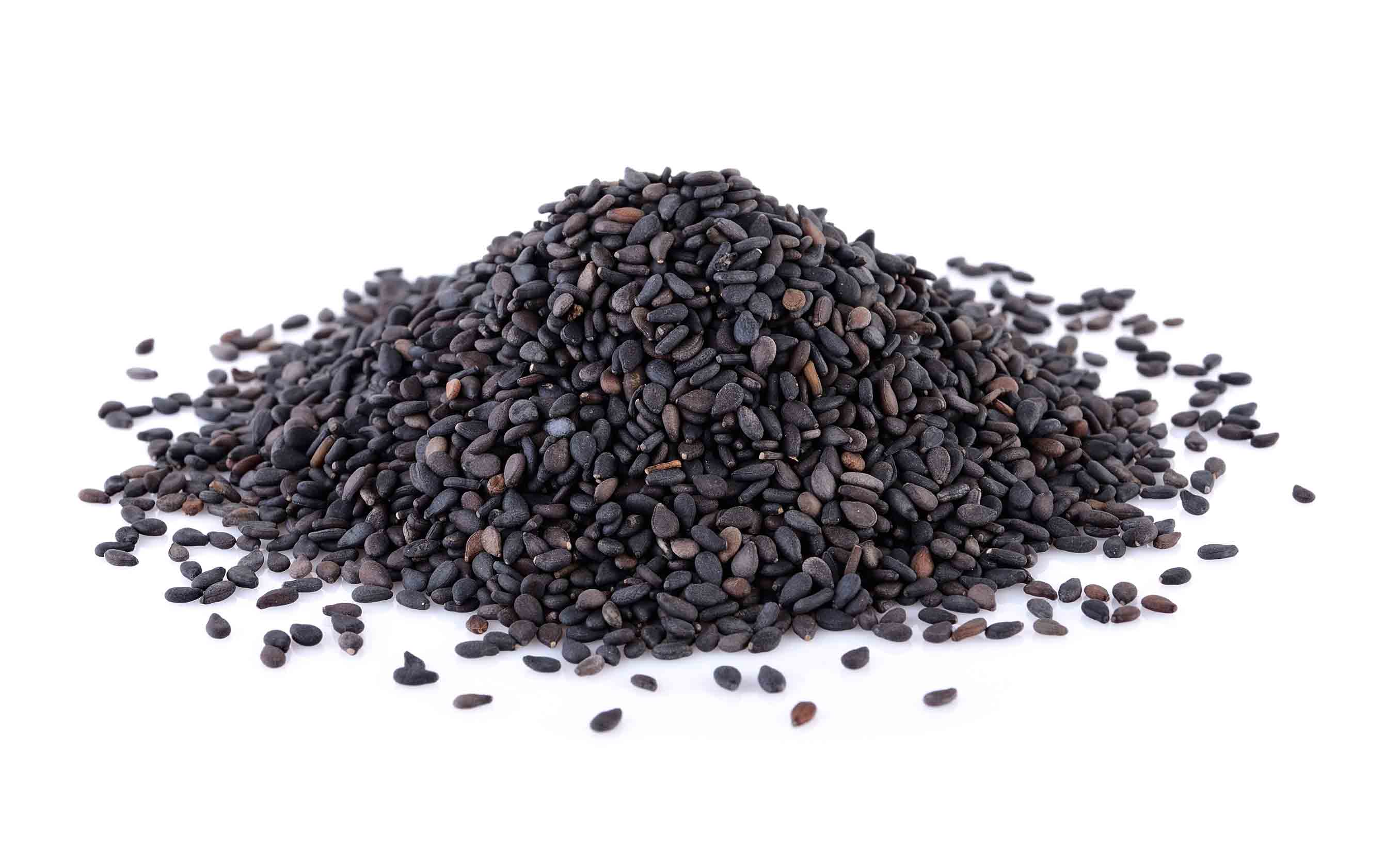 A pile of black sesame seeds used as a nigella seed substitute