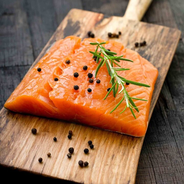 Raw salmon on a cutting board