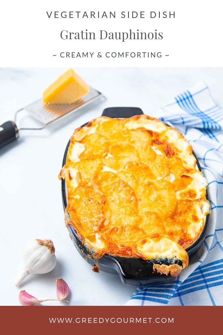 Casserole dish of gratin dauphinois and chunk of cheese