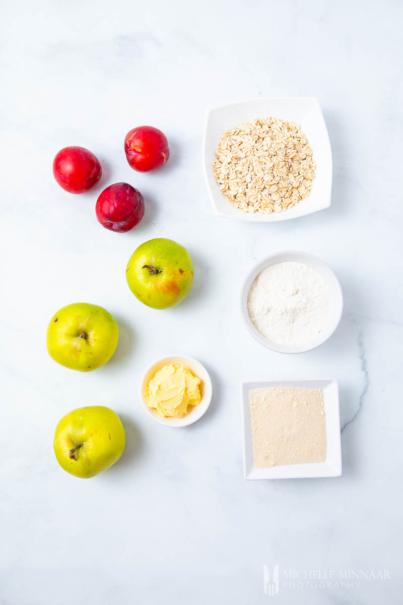 Ingredients to make apple and plum crumble