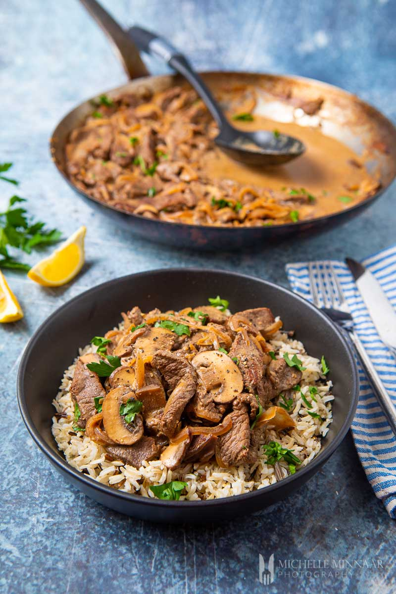A bowl of rice covered in slimming world beef stroganoff