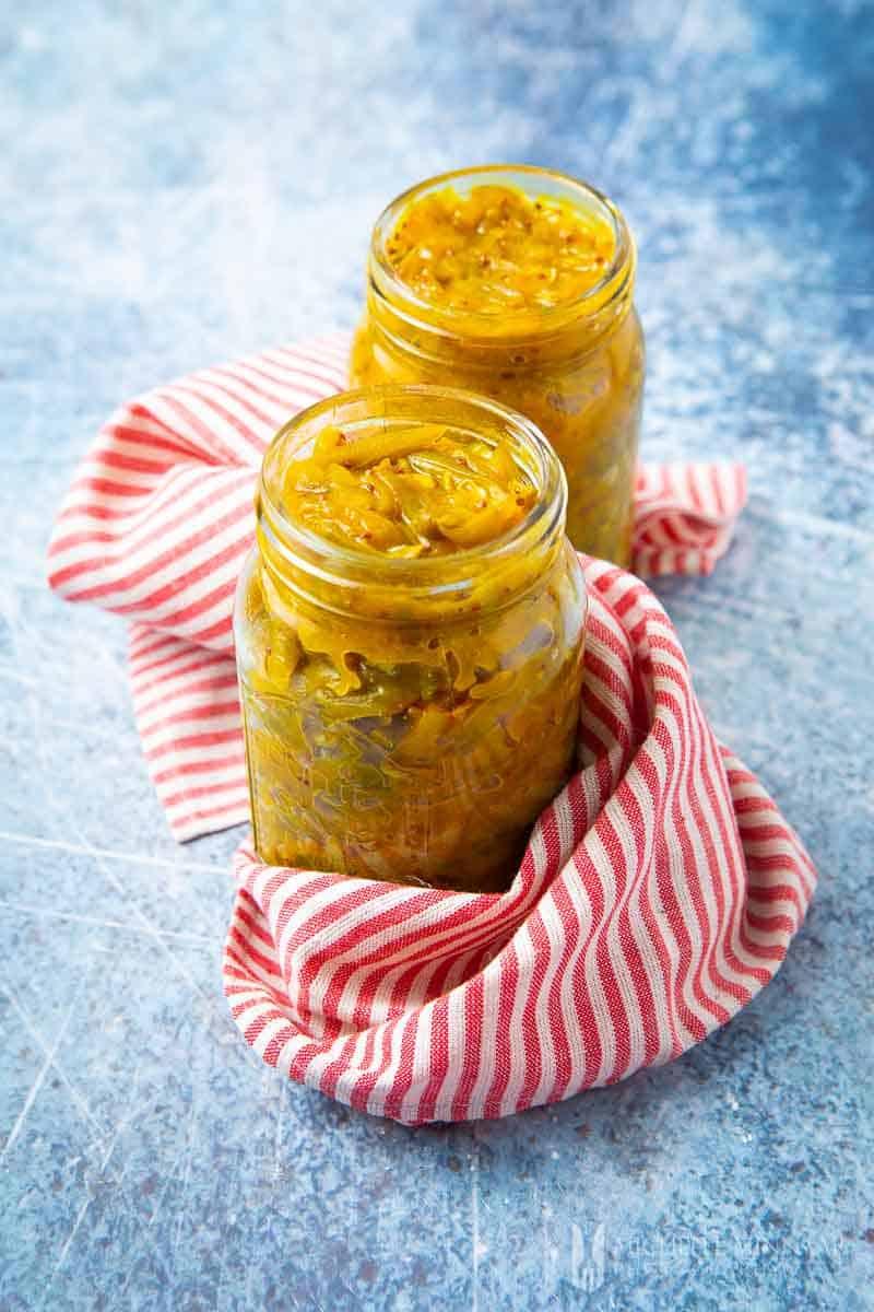 Two jars of yellow runner bean chutney
