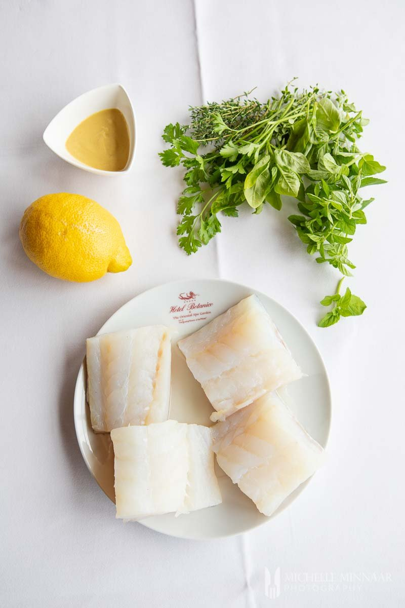 A plate of raw cod to make steamed cod