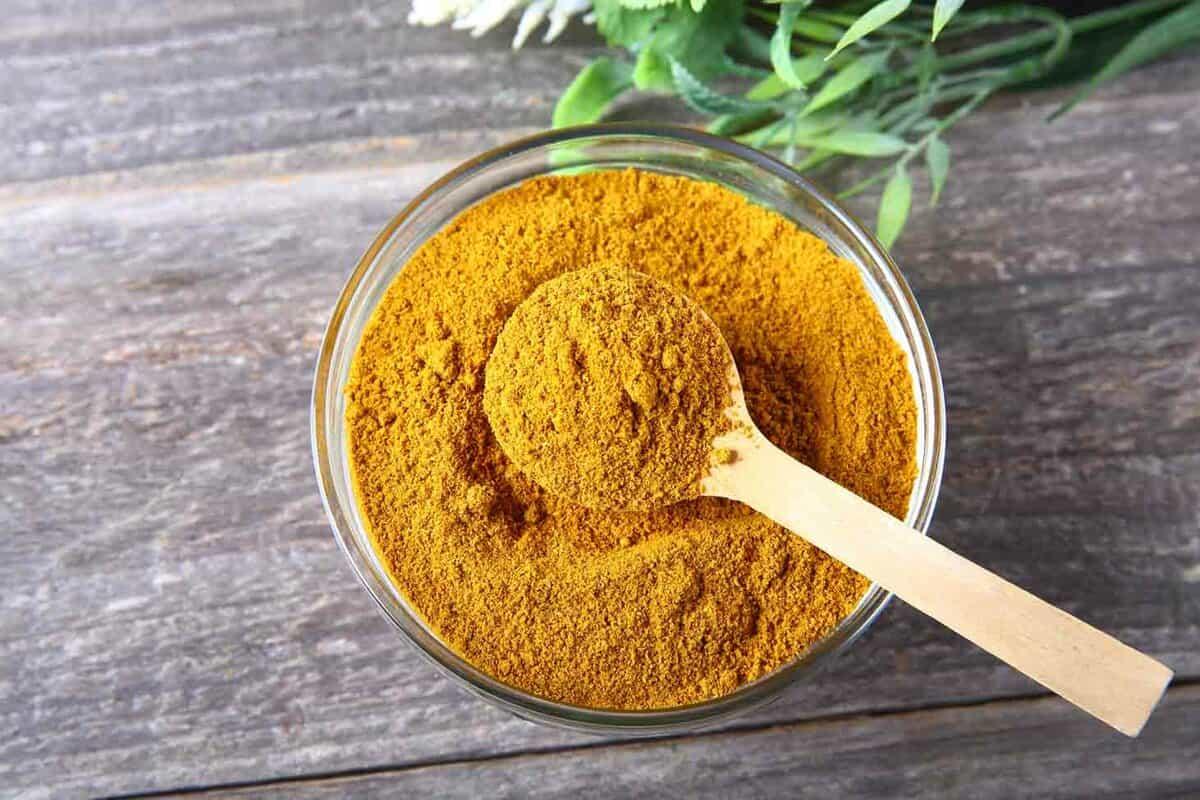 a bowl of orange curry powder