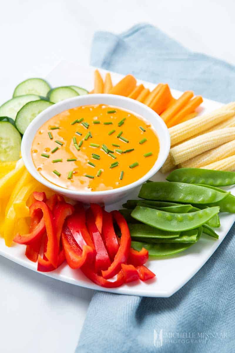 Orange harissa aioli with chives and vegetables