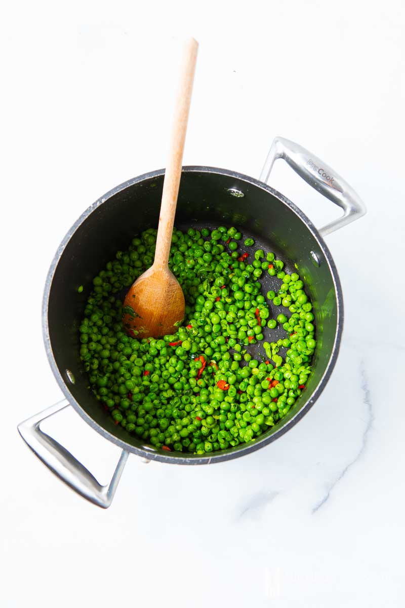 Peas simmering in a pot