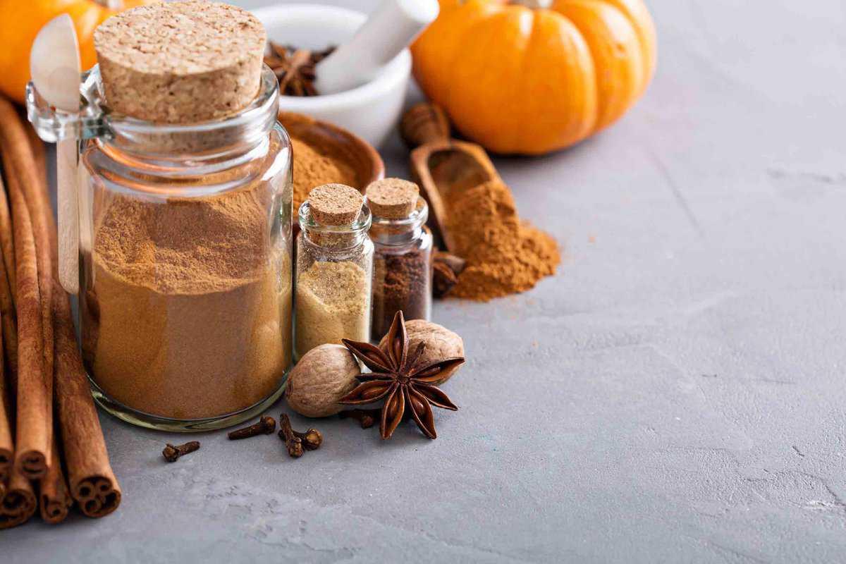 Glass jars of brown pumpkin powder