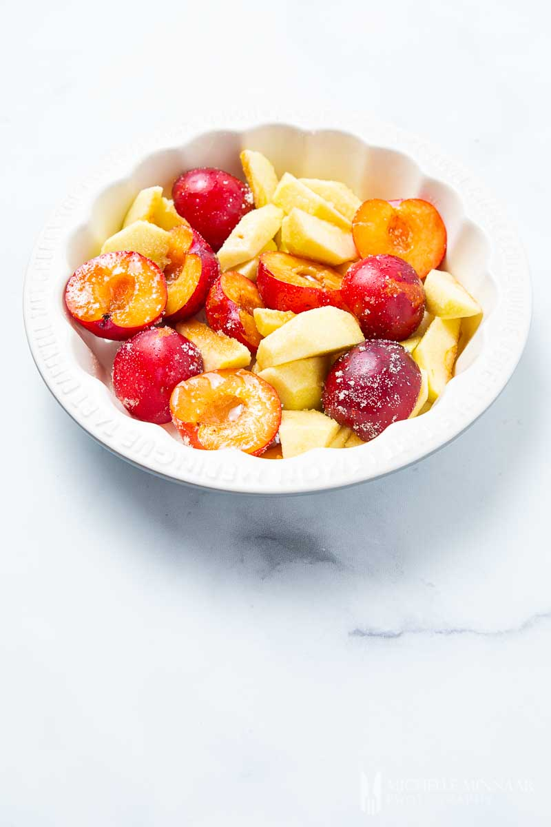Bowl of cut fresh apples and pears