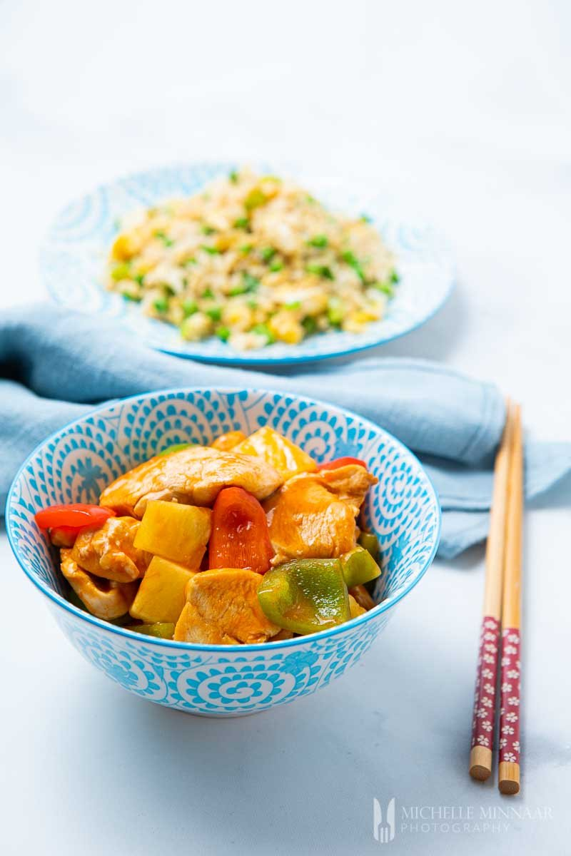 Bowl of fanta chicken, peppers and pineapple