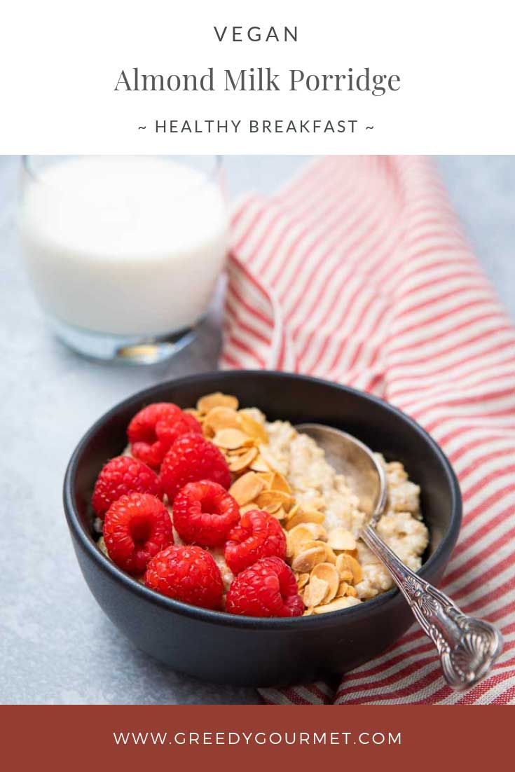 Bowl of almond milk porridge topped with raspberries