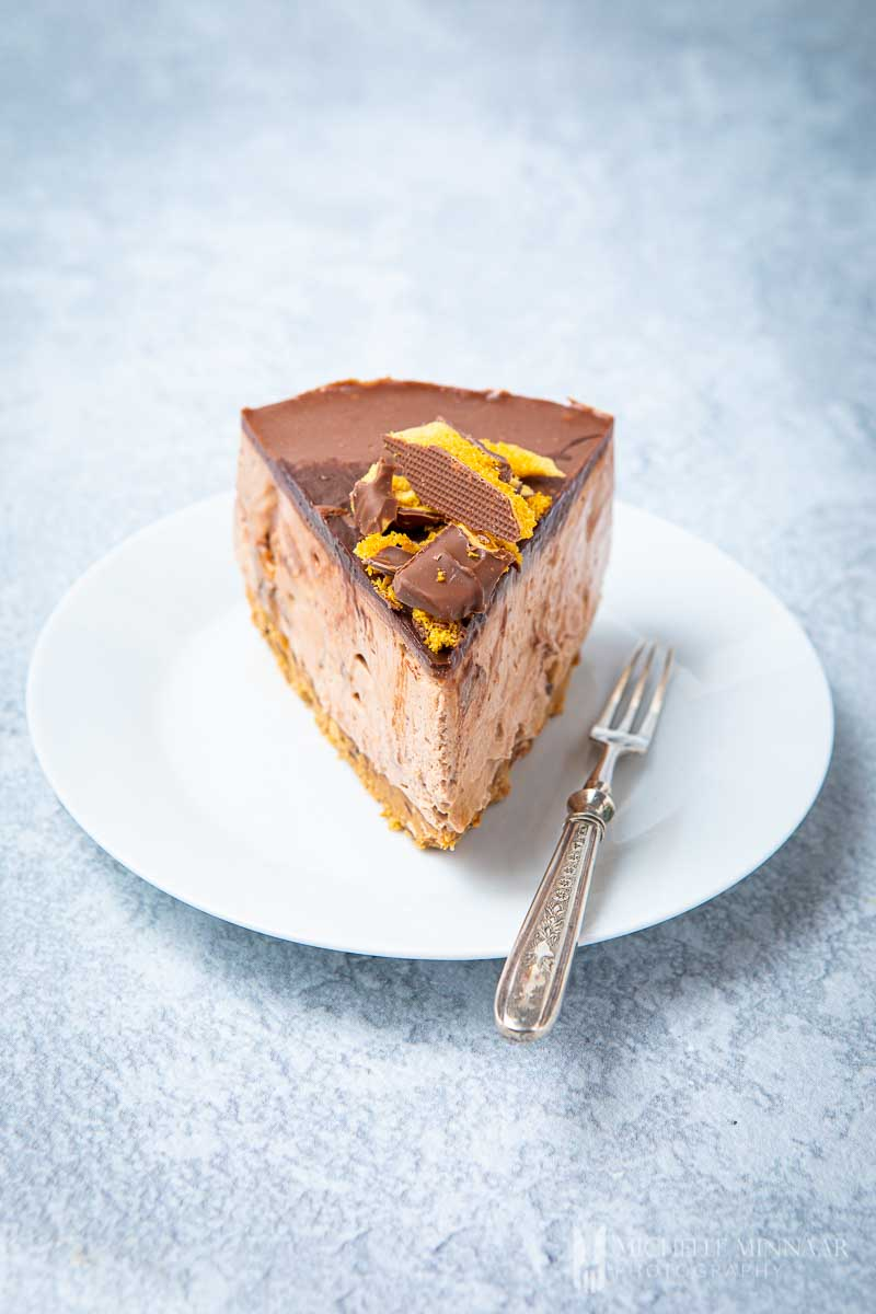 Slice of Crunchie cheesecake