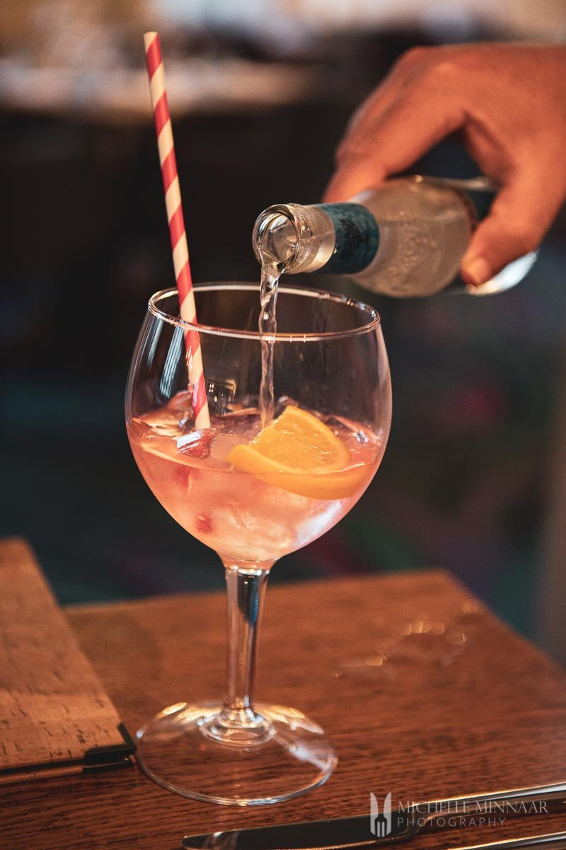 Liquid being poured into a cocktail glass
