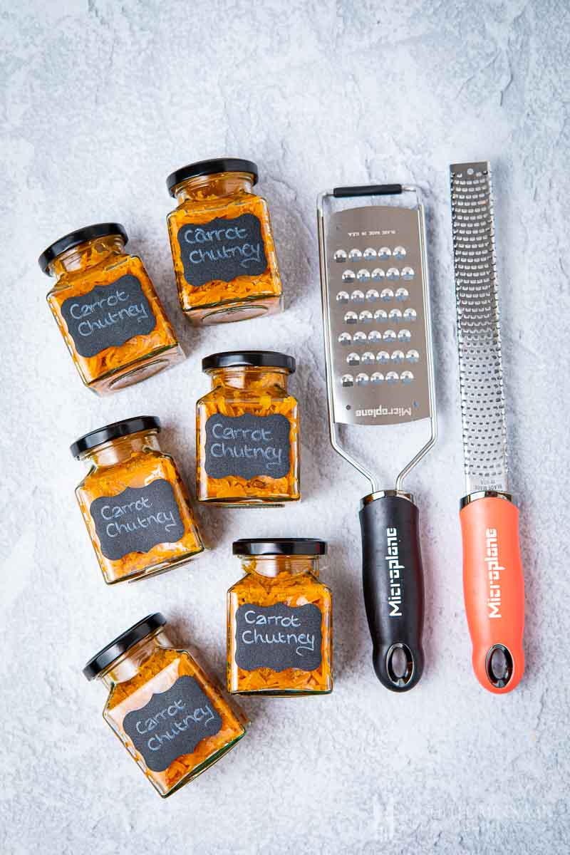 Jars of carrot chutney and a grater and zester