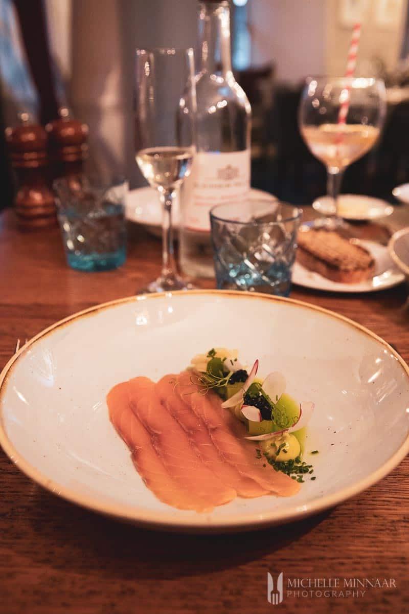Raw seafood on a plate as sashimi